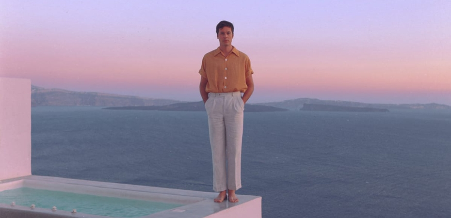 Ernest Greene aka Washed Out stood in front of purple sunset