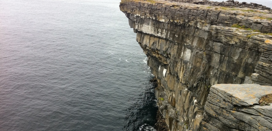Cliff edge standing over water