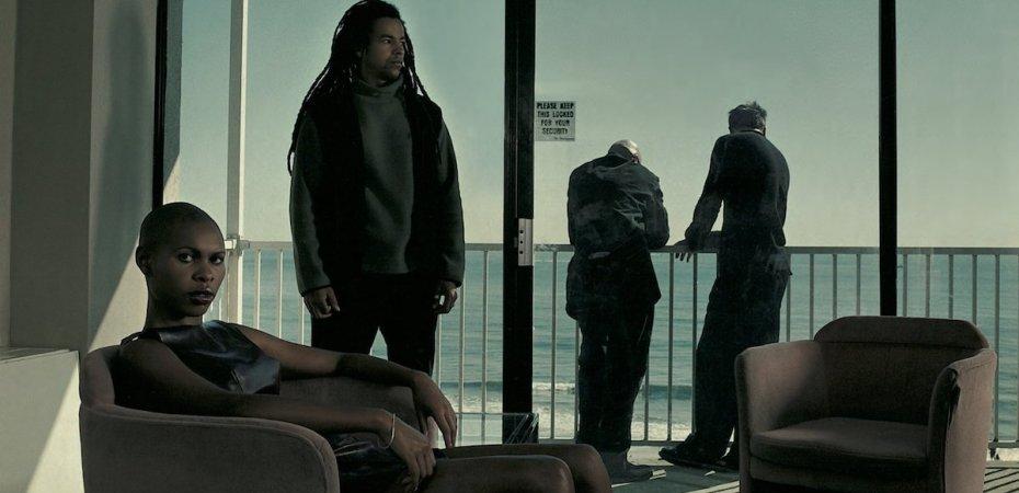 Members of Skunk Anansie sat in a room overlooking the sea
