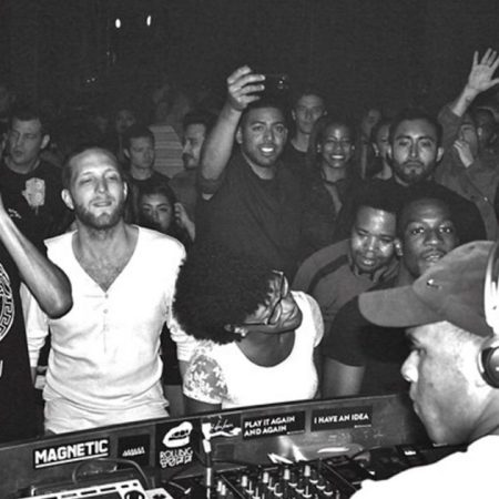 Black and white image of UK Garage night, from behind the decks